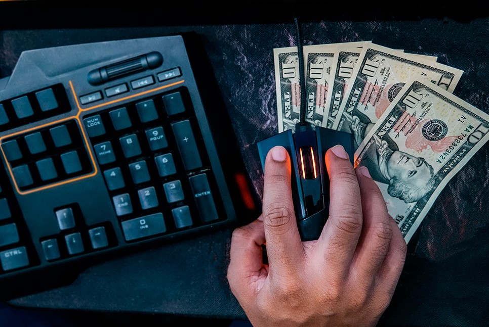 Dollars under computer mouse